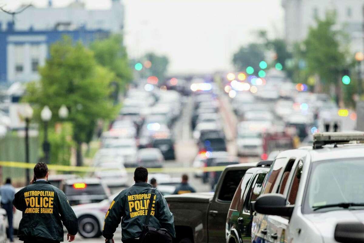 A large police presence gathers along M Street in Southeast Washington Thursday, near the Washington Navy Yard campus.