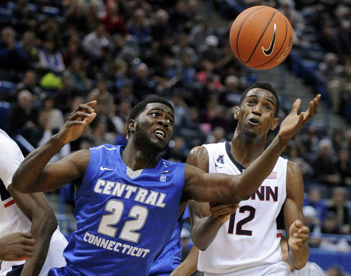Central Connecticut State's Faronte Drakeford, left, and UConn's Kentan Facey battle for a rebound during the second half of Sunday's game.