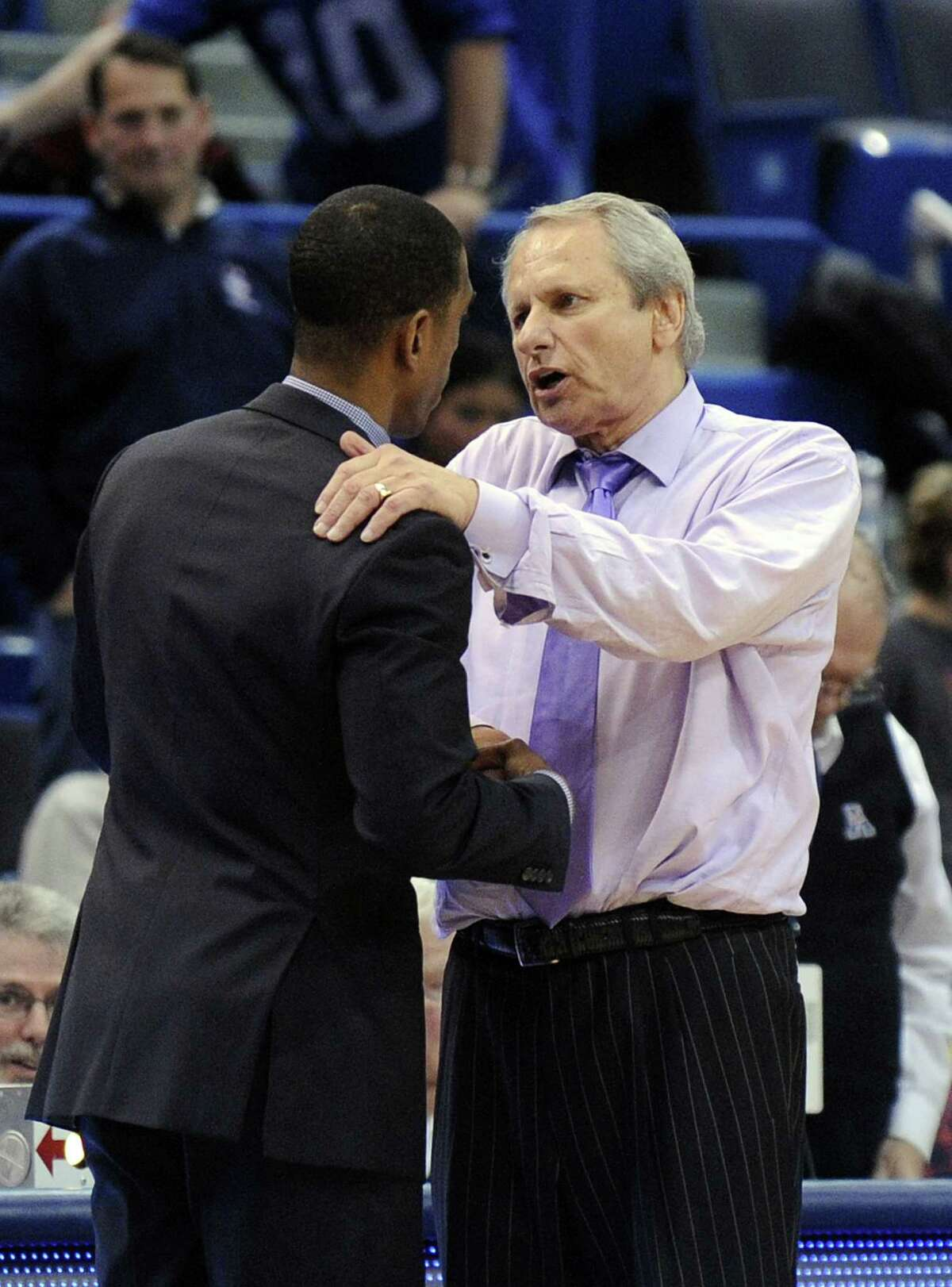 UConn head coach Kevin Ollie, left, and Central Connecticut State coach Howie Dickenman speak after UConn's 81-48 victory on Sunday.