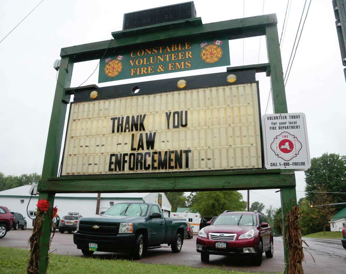 A sign at the Constable Volunteer Fire and EMS thanks law enforcement after the second of two escaped prisoners was apprehended on Sunday, June 28, 2015, in Constable, N.Y. David Sweat, the second of two convicted murderers who staged a brazen escape three weeks ago from a maximum-security prison in northern New York, was shot and captured near the Canadian border on Sunday, two days after his fellow inmate was killed in a confrontation with law enforcement officers, a sheriff said. (AP Photo/Mike Groll)