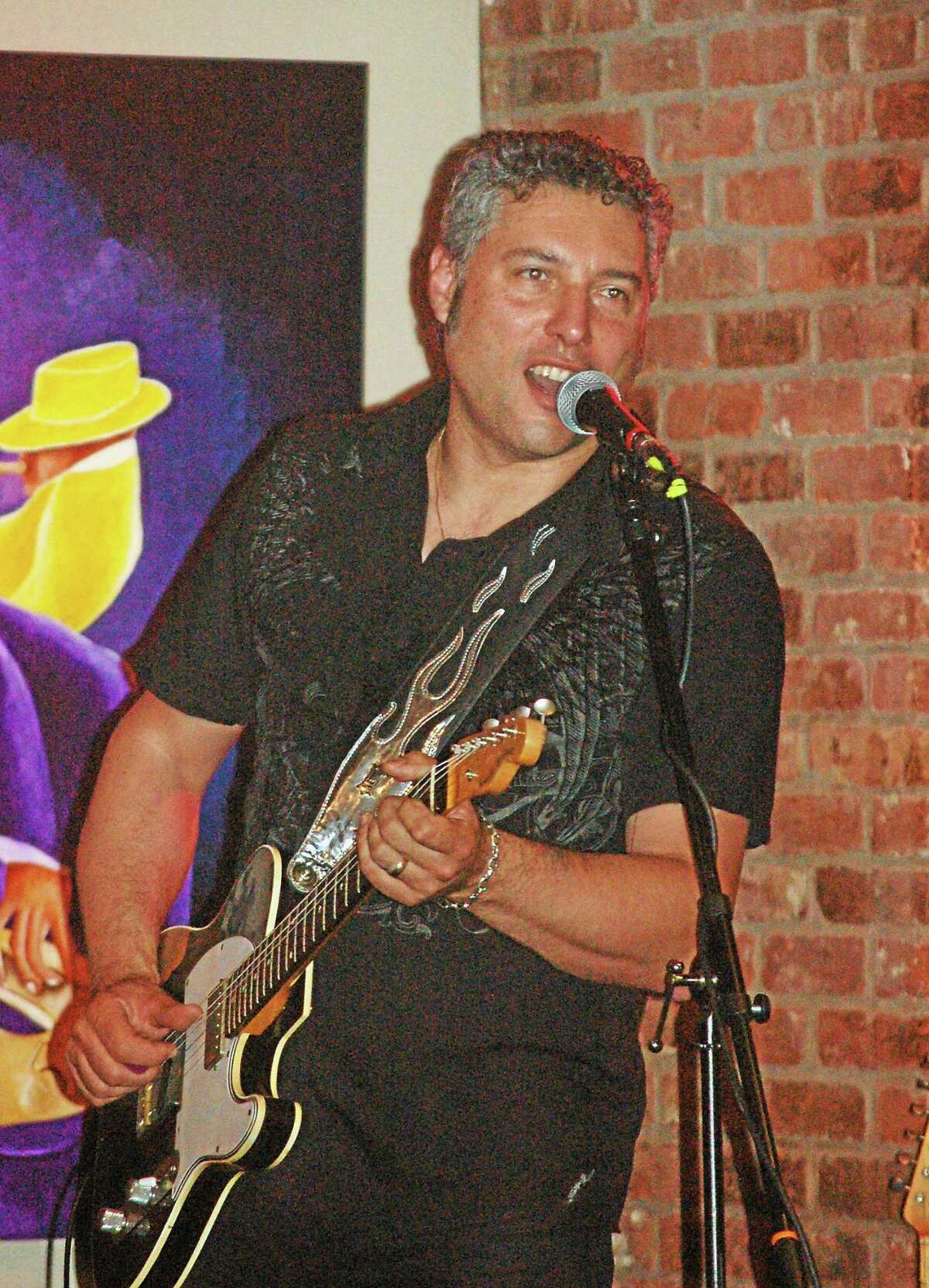 Photo by Domenic Forcella Roberto Morbioli is playing at the Cypress Restaurant in Middletown Friday.
