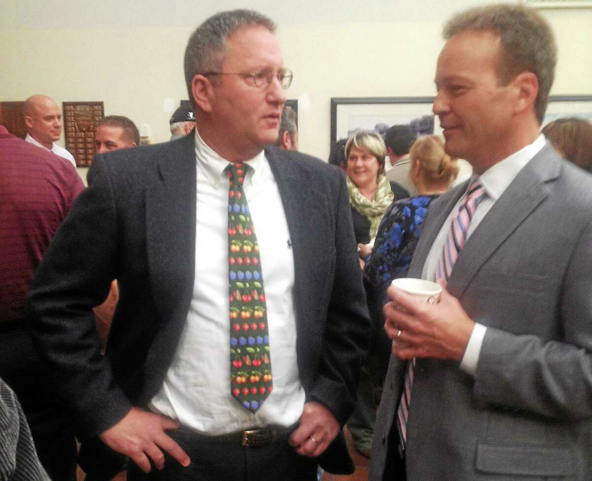 Cromwell Town manager Jon Sistare, left, chats with Board of Education member Philip Gagnon in this 2013 photo.