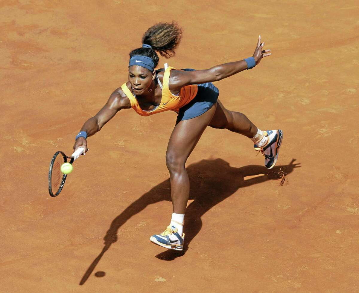 Serena Williams of the United States returns the ball to Belarus' Victoria Azarenka during their final match at the Italian Open tennis tournament in Rome on May 19, 2013. Williams won 6-1, 6-3.
