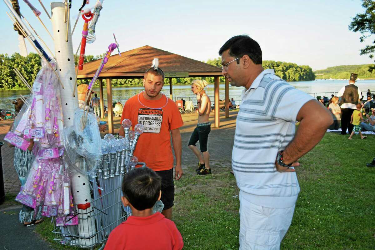 Middletown's Fourth of July festival, moved from a rainy Thursday to a balmy and beautiful Saturday drew thousands of folks both to the city hall lawn and Harbor Park with spectacular views of the Connecticut River for live concerts followed by fireworks at dusk.