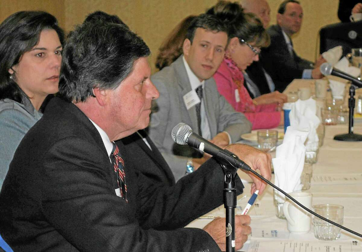 File photo State Rep. Emil Altobello, D-82, speaks during the Middlesex Chamber Legislative Breakfast in Cromwell last year while state Sen. Dante Bartolomeo, D-13, and state Rep. Matt Lesser, D-100, listen.