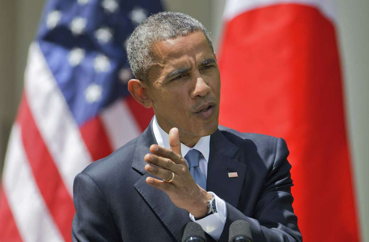 President Barack Obama speaks during a joint news conference Tuesday in the Rose Garden of the White House in Washington.