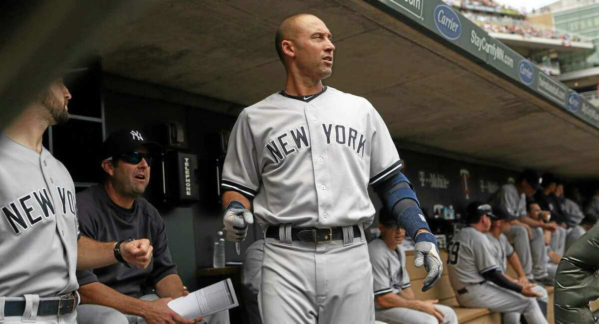 New York Yankees' Derek Jeter looks out onto the field before the Yankees' baseball game against the Minnesota Twins on Saturday, July 5, 2014, in Minneapolis. The Twins won 2-1 in 11 innings. (AP Photo/Star Tribune, Kyndell Harkness)