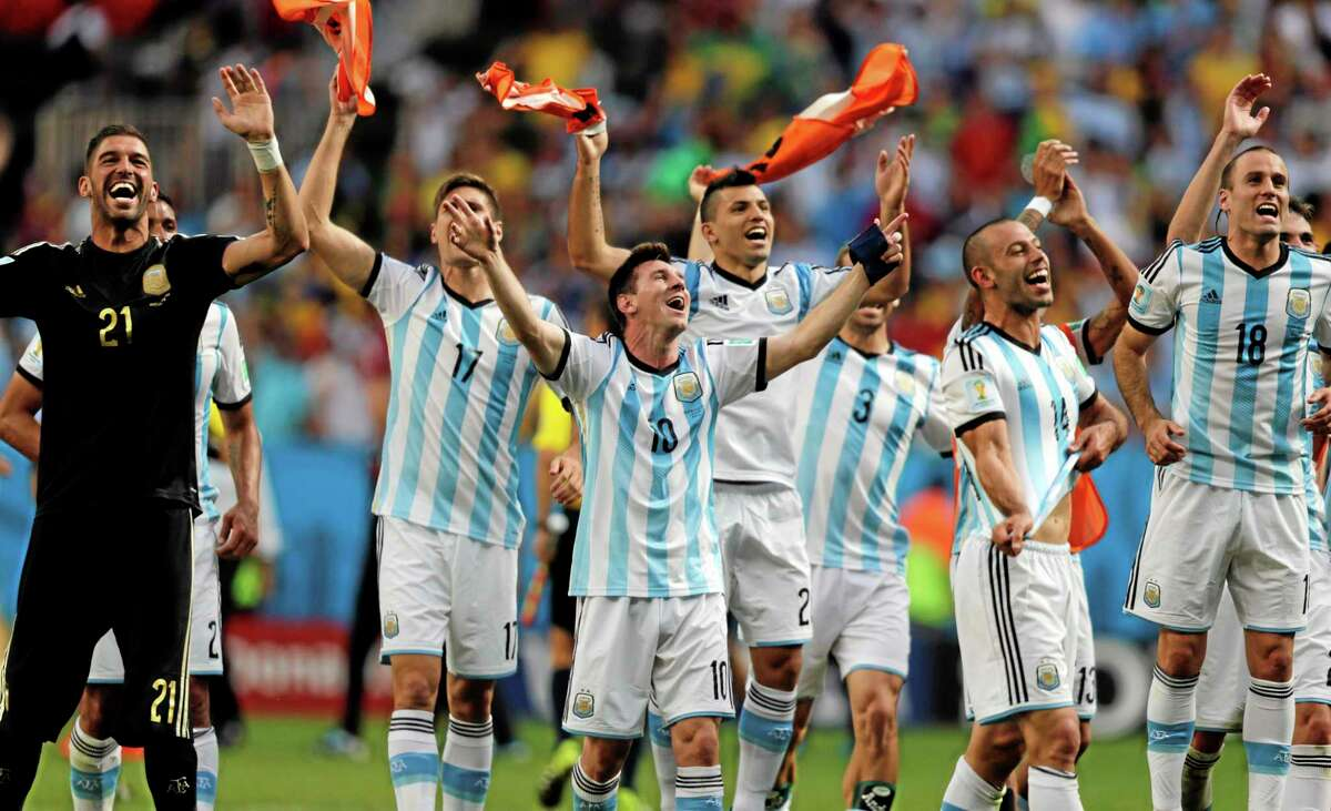 Argentina's Lionel Messi and teammates celebrate at the end of their World Cup quarterfinal match against Belgium Saturday at the Estadio Nacional in Brasilia, Brazil. Argentina won 1-0.