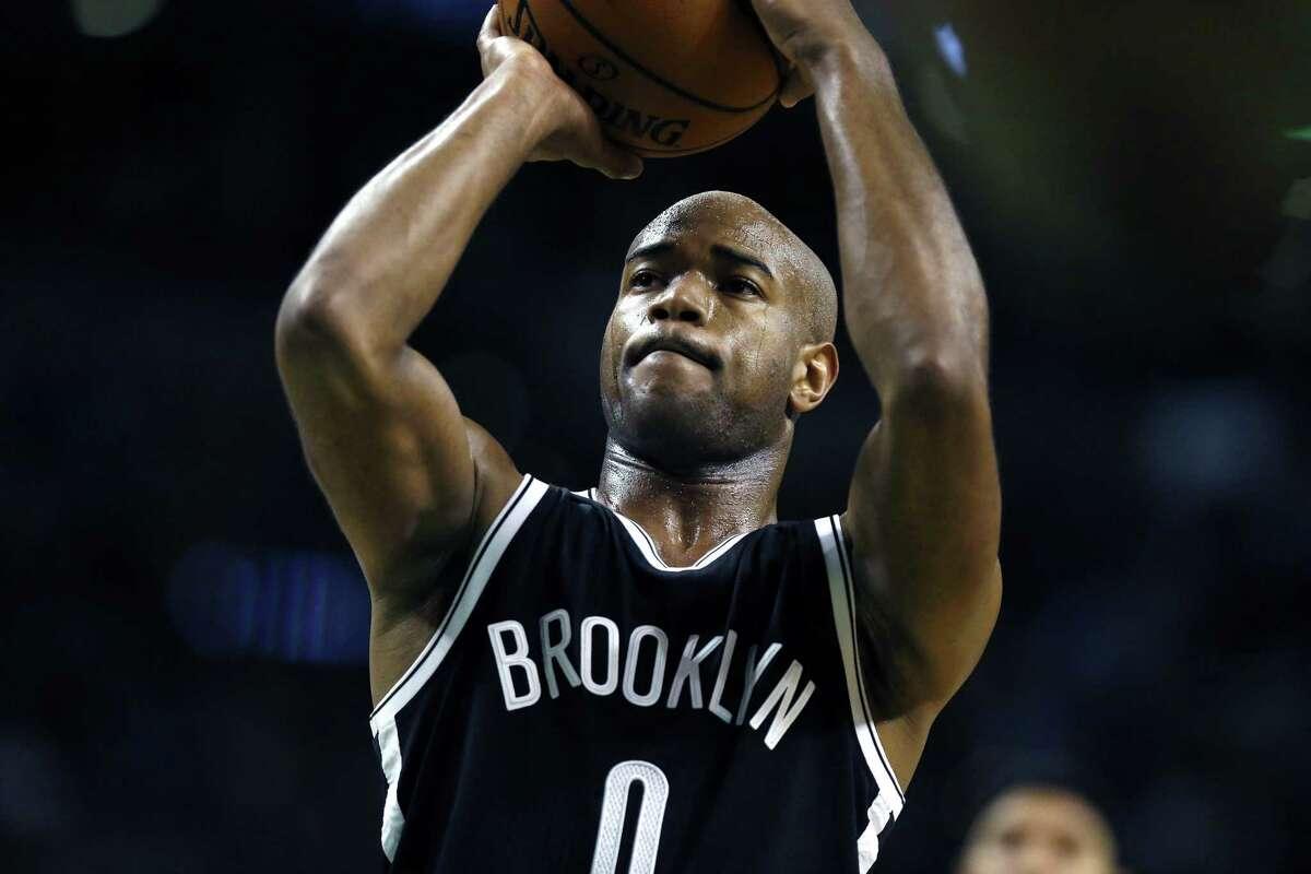 Brooklyn Nets' Jarrett Jack (0) shoots a free throw in the third quarter of an NBA basketball game against the Boston Celtics in Boston, Friday, Dec. 26, 2014. The Nets won 109-107. (AP Photo/Michael Dwyer)