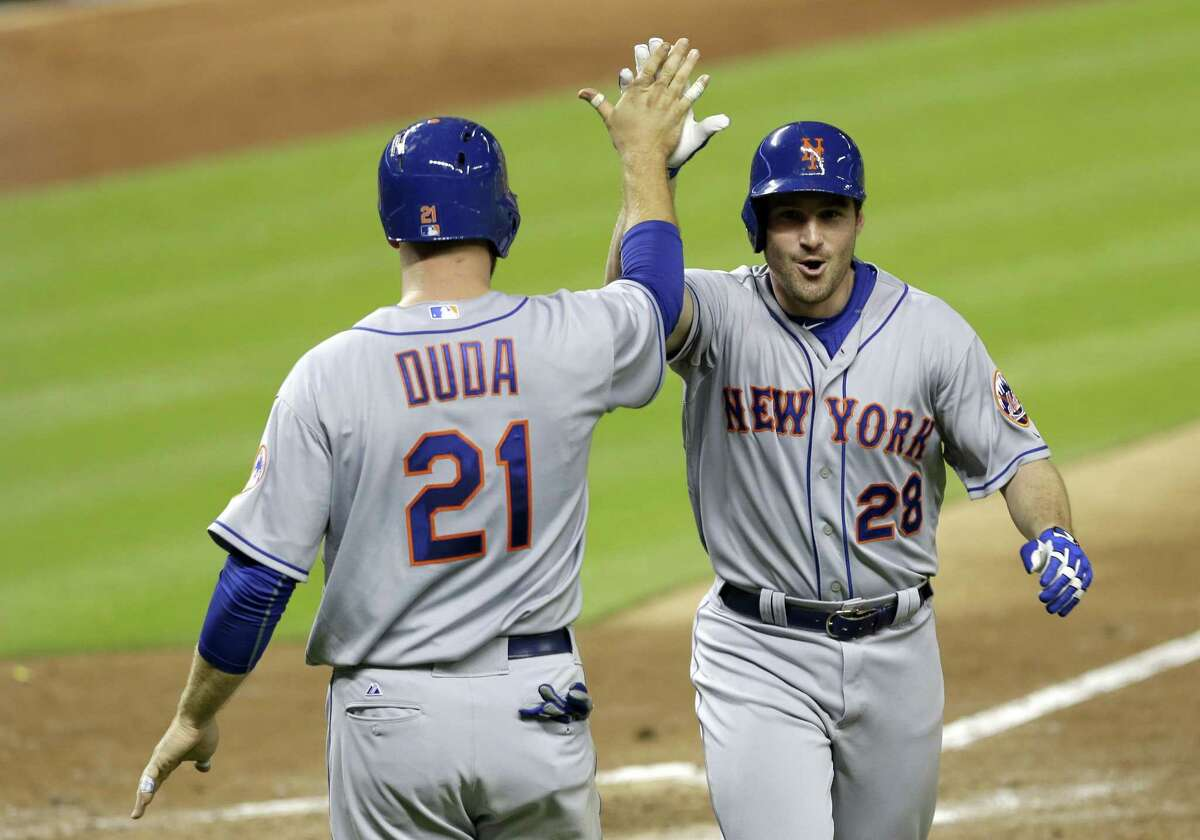 The Mets' Daniel Murphy (28) is congratulated by teammate Lucas Duda after Murphy hit a three-run home run against the Marlins on Monday.