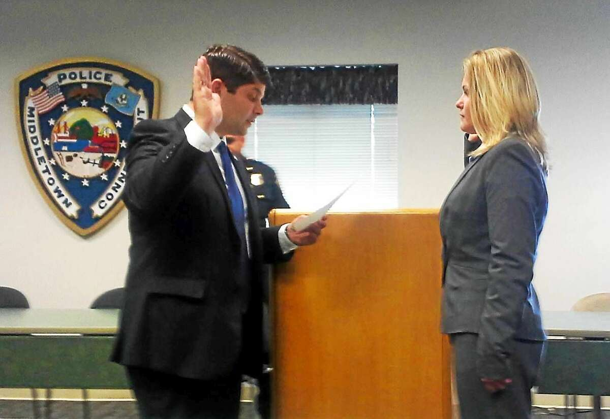 Mayor Dan Drew swears in Middletown's newest police officer, Ilona Bak.