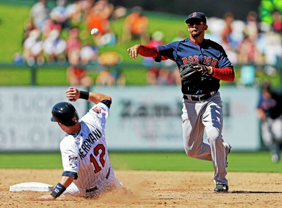 Minnesota Twins runner Chris Herrmann is forced out at second on a fielder's choice as Boston Red Sox shortstop Deven Marrero throws to first during a spring training game in March in Fort Myers, Fla.