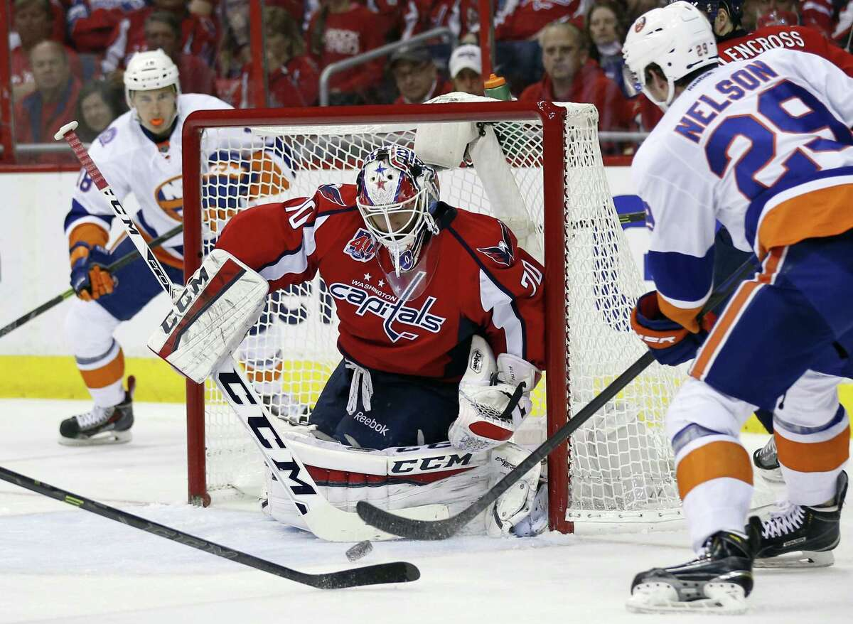 Capitals goalie Braden Holtby (70) blocks a shot by Islanders center Brock Nelson (29) during the second period of Game 7 on Monday.