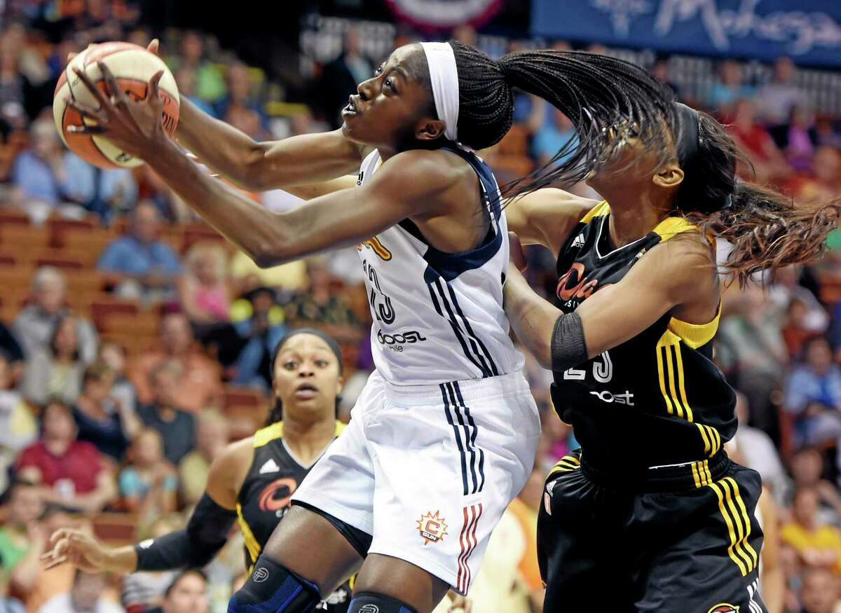 The Sun's Chiney Ogwumike, front left, beats Tulsa Shock's Glory Johnson to a rebound during a July 3 game.