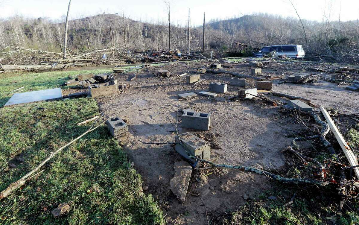 Concrete blocks from the foundation of the home of Antonio Yzaguirre, and his wife, Ann Yzaguirre, show Thursday where the house once stood after severe storms went through the area Wednesday night near Linden, Tenn. The couple was killed in the storm.