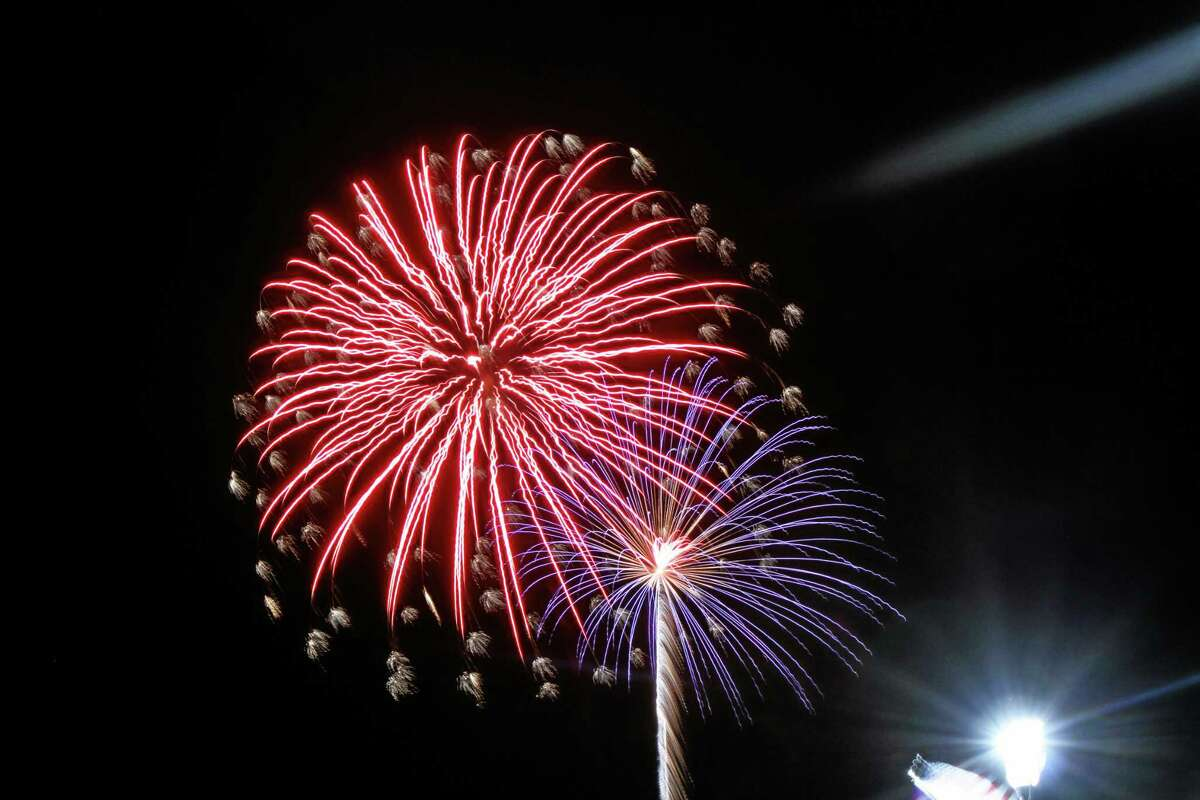 The 2014 fireworks show lights up the sky at the harbor in Atlantic Highlands, N.J., Friday, July 4, 2014. (AP Photo/The Asbury Park Press, Mike DeSocio