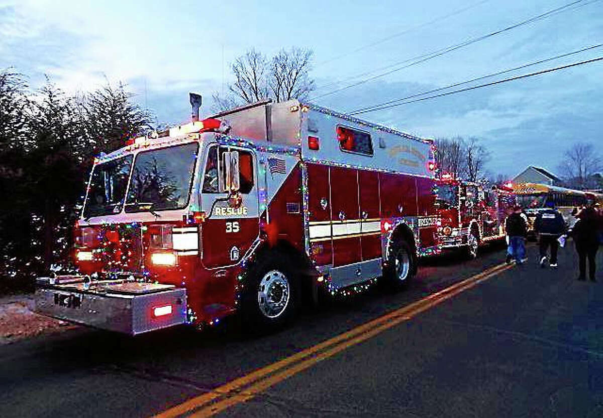 Courtesy South Fire District A parade of fire trucks delivers Santa to a party hosted by the Elks Club for local families.