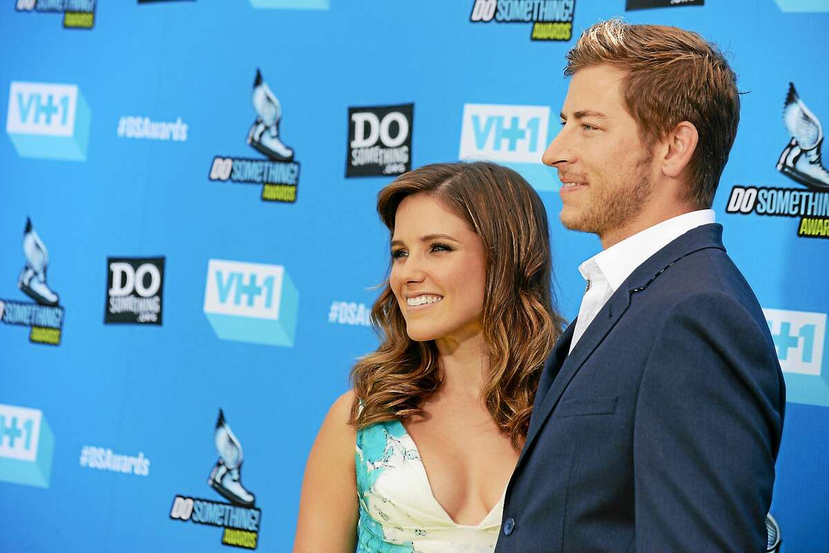 (Photo by Jordan Strauss/Invision/AP) Sophia Bush, left, and Dan Fredinburg arrive at the Do Something Awards at the Avalon on July 31, 2013, in Los Angeles.