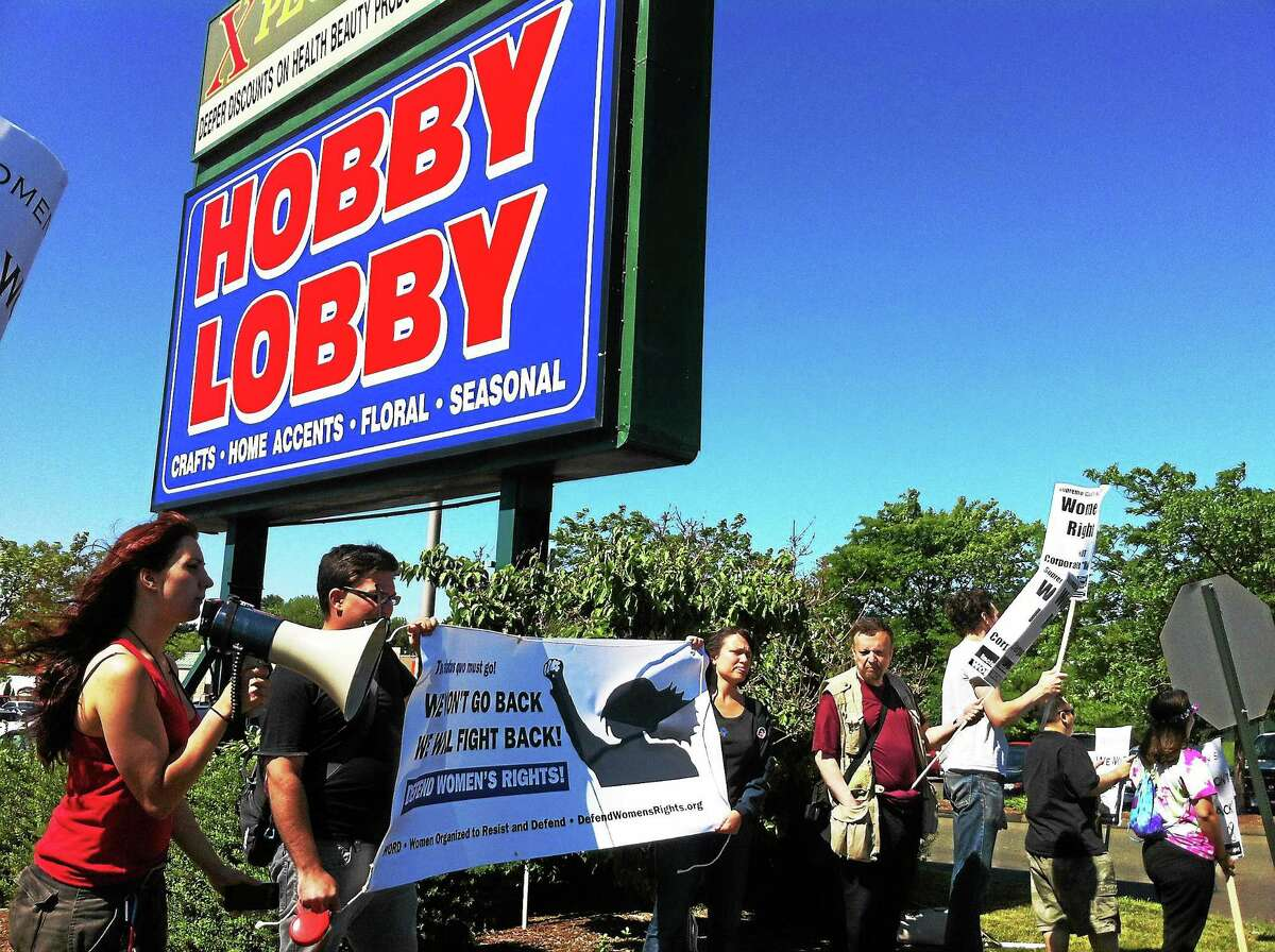Members of Women Organized to Resist and Defend and other people from towns across Connecticut rally at the Hobby Lobby store in East Haven against a recent Supreme Court decision involving the company. The protesters said the decision is a major setback for women's and employee rights. (Wes Duplantier -- New Haven Register)