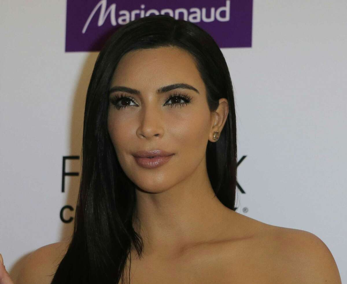 Kim Kardashian attends a photocall April 15 to launch hair products in Paris.