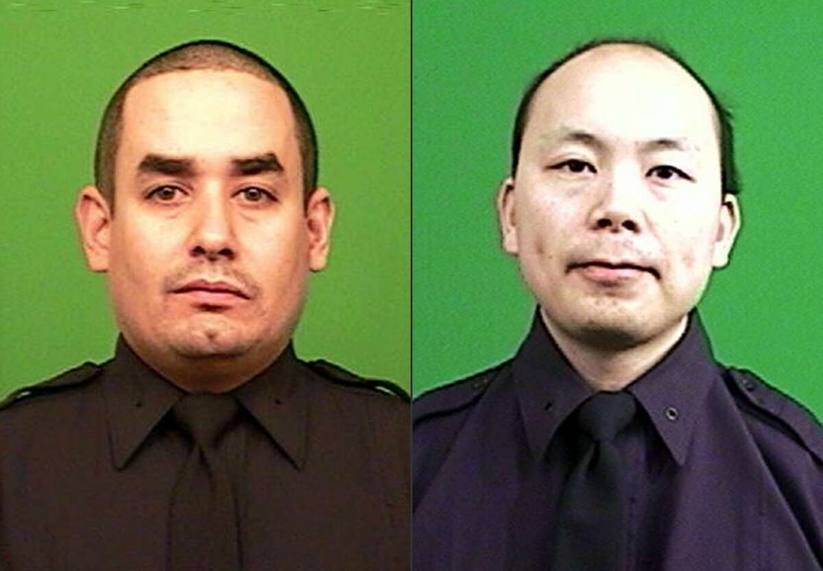 This combination made from photos provided by the New York Police Department shows officers Rafael Ramos, left, and Wenjian Liu.