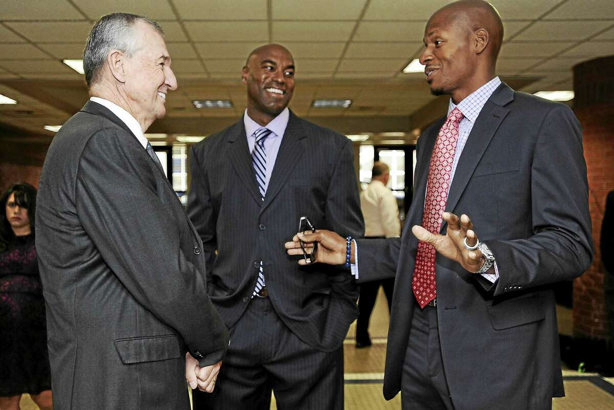 Hamden's Scott Burrell, center, here with Jim Calhoun, left, and Ray Allen at a ceremony honoring Calhoun's coaching career at UConn, is expected to be the next Southern Connecticut State men's basketball coach.