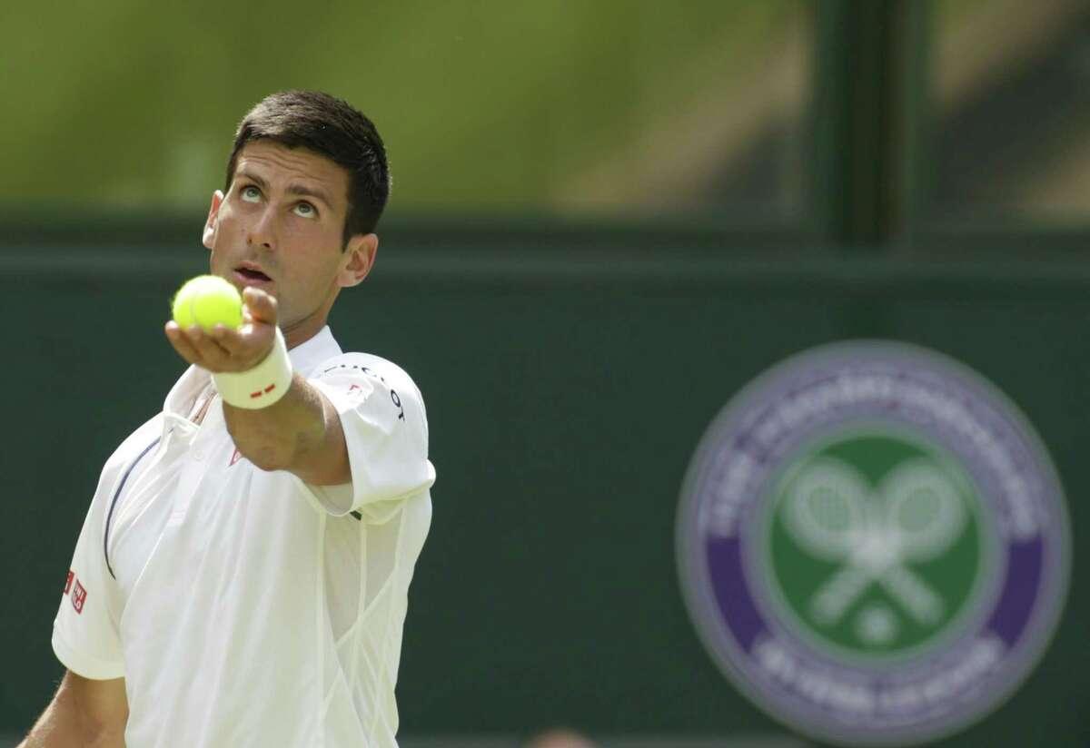 Novak Djokovic prepares to serve to Jarkko Nieminen during their Wednesday match at the All England Lawn Tennis Championships in Wimbledon, London.