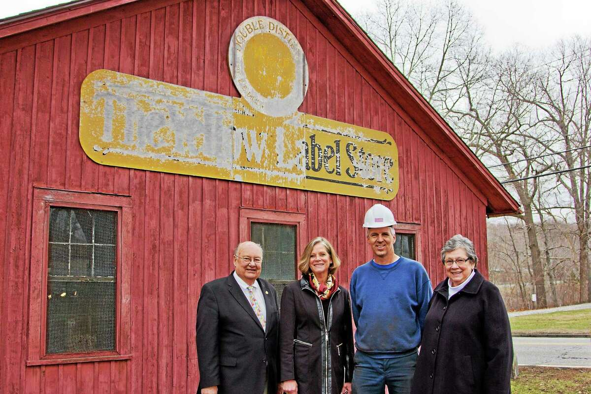 The upcoming Dickinson Initiative is a series of five events that details the impact of the E. E. Dickinson Witch Hazel business on Essex. Essex Historical Society members Herb Clark, Susan Malan and Sherry Clark are shown outside the Yellow Label Building with Rob Bradway of the Valley Railroad (second from right).