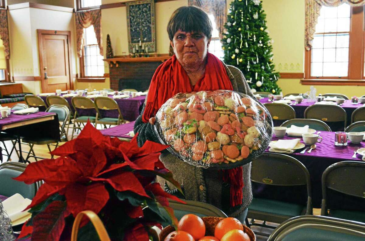 Julie Hurlburt, organizer of the annual First Church Congregational community Christmas dinner, Hurlburt said volunteers will deliver 86 to-go meals to those who can't make it. Nearly 500 are expected to fill the festively decorated hall.