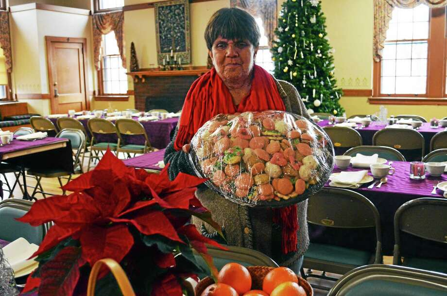 Julie Hurlburt, organizer of the annual First Church Congregational community Christmas dinner, Hurlburt said volunteers will deliver 86 to-go meals to those who can't make it. Nearly 500 are expected to fill the festively decorated hall. Photo: Cassandra Day — The Middletown Press