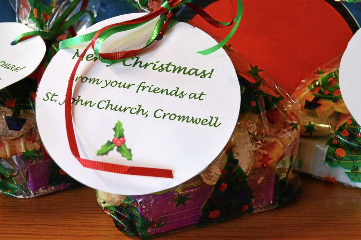 Dessert gift packages made by parishioners of St. John's Church in Cromwell join other homemade desserts like cupcakes and a giant platter of holiday treats baked by residents of One Macdonough Place in Middletown.