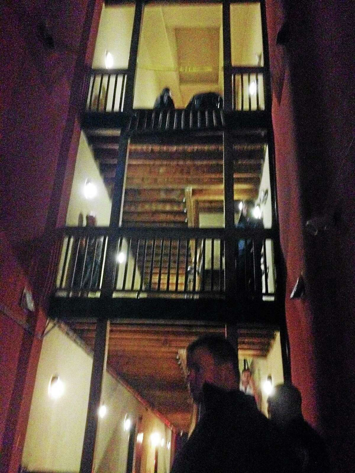 A witness took this photo following an incident in which police say a teen fell from a third-story window at the Wharfside Commons. apartment building in Middletown. Police arrested 21-year-old man shortly afterward on risk of injury, assault and other charges.