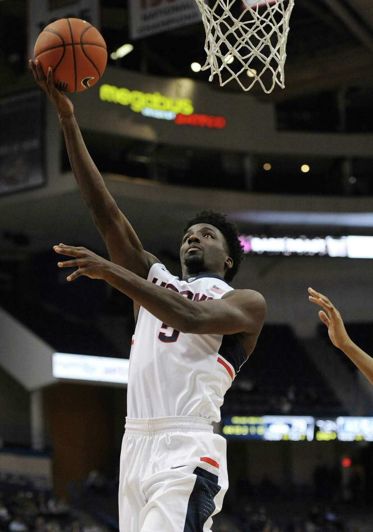 Connecticut's Daniel Hamilton goes up for a basket in the second half of an NCAA college basketball game against Central Connecticut State, Wednesday, Dec. 23, 2015, in Hartford, Conn. UConn won 99-52. (AP Photo/Jessica Hill)