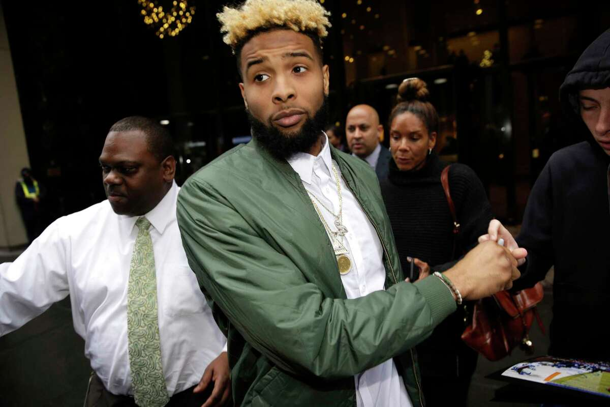 New York Giants' Odell Beckham Jr. leaves NFL headquarters in New York, Wednesday, Dec. 23, 2015. Hearing officer James Thrash upheld the suspension for multiple violations of safety-related playing rules after hearing an appeal by the New York Giants wide receiver earlier in the day. Beckham will miss the game Sunday night at Minnesota. (AP Photo/Seth Wenig)