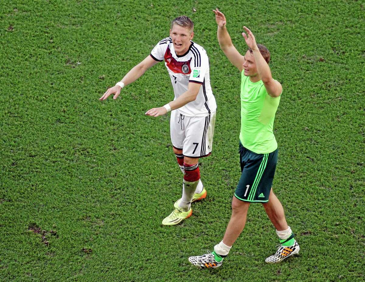 Germany's Bastian Schweinsteiger, left, and Manuel Neuer celebrate after their World Cup quarterfinal win over France Friday at the Maracana Stadium in Rio de Janeiro.