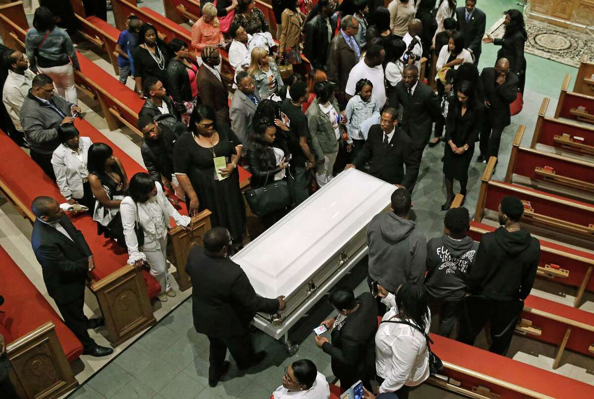 Pallbearers guide a casket containing the body of Freddie Gray out of New Shiloh Baptist Church after his funeral Monday in Baltimore.