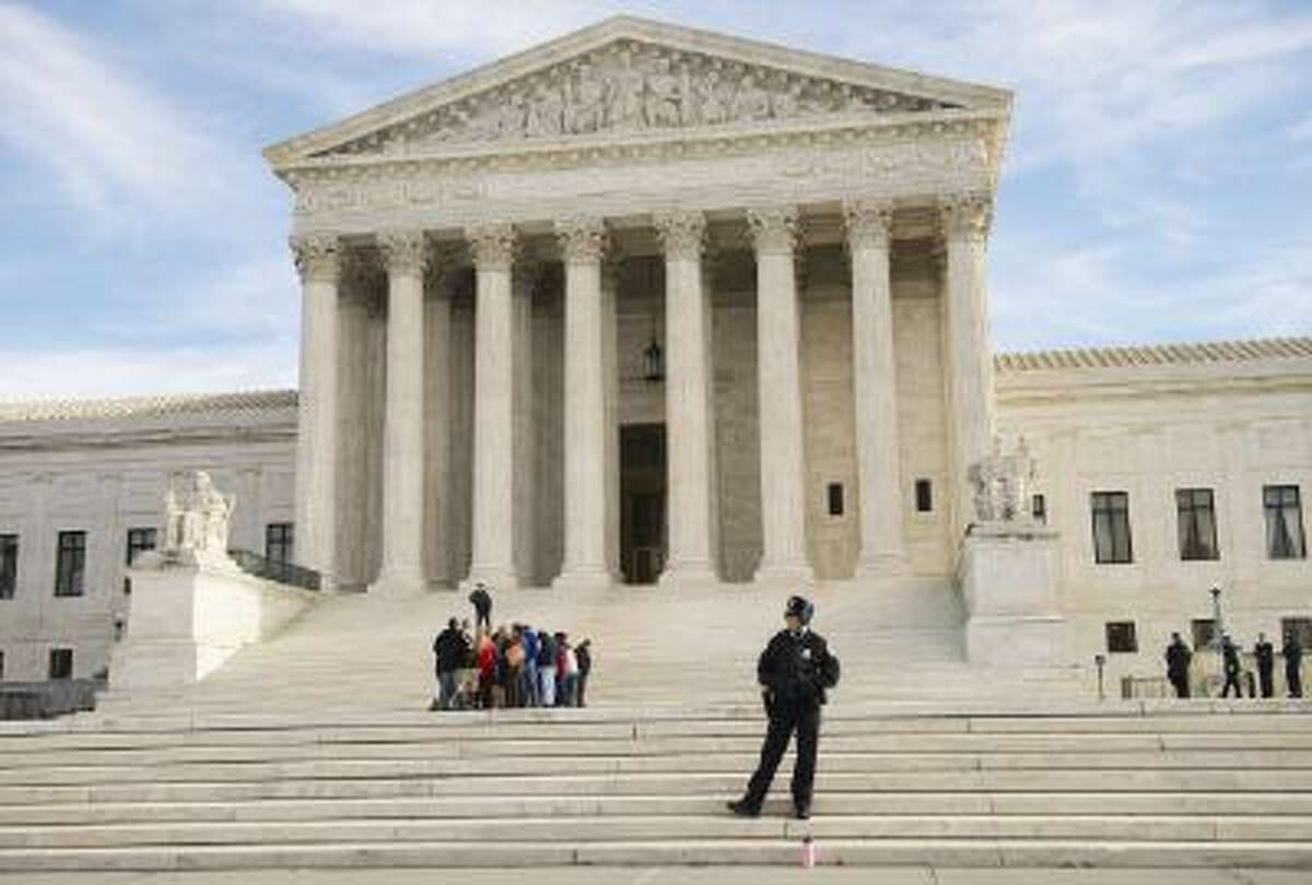 UNITED STATES - JANUARY 13: Visitors line up in front of the Supreme Court to hear oral arguments on the power of Presidential appointments. (Photo By Tom Williams/CQ Roll Call)