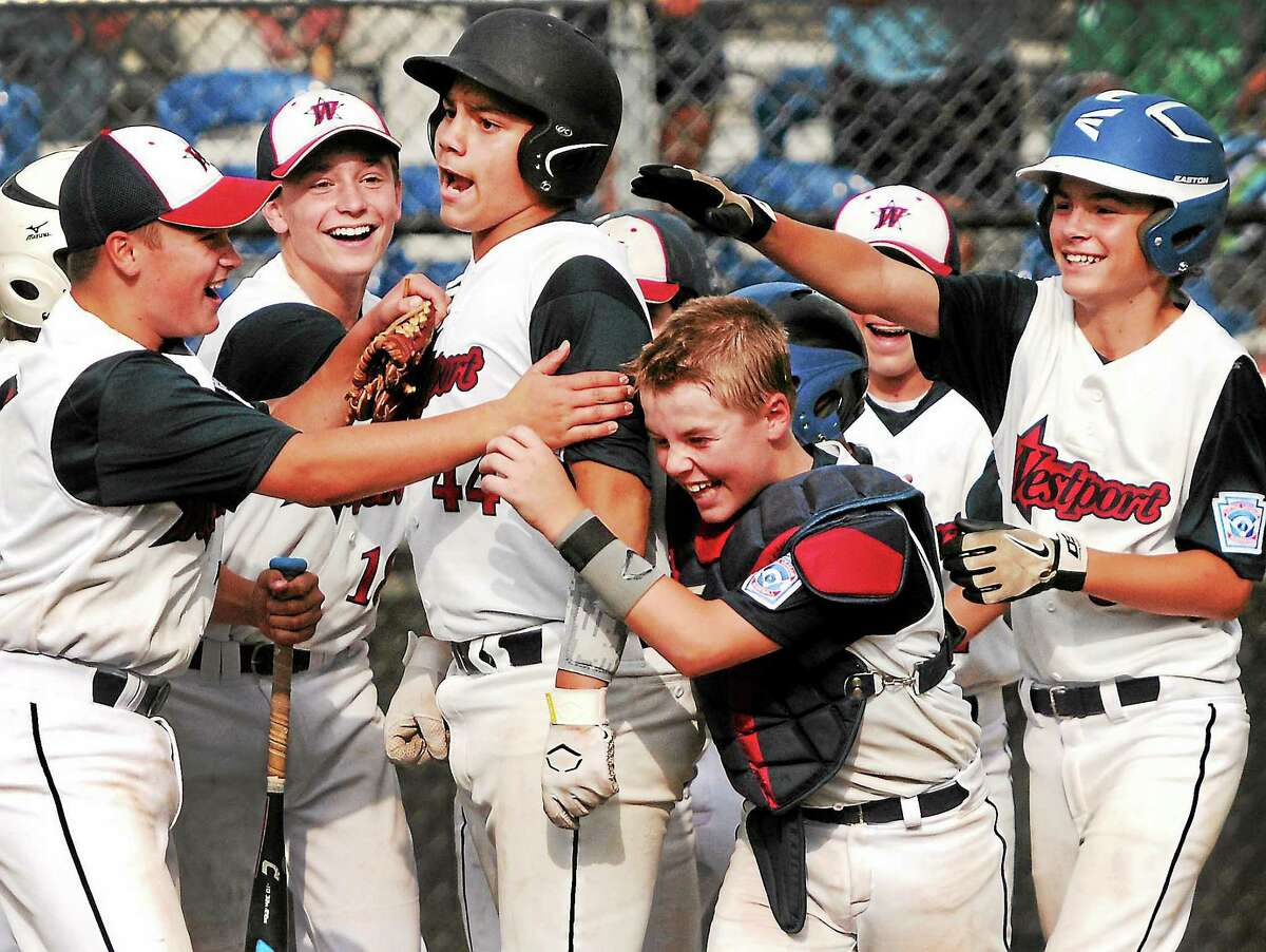 Peter Hvizdak — new haven register Westport Little League players congratulate teammate Matthew Brown after Brown's homer in the 2013 Eastern Regionals in Bristol. Westport's run in the Little League World Series was one of the best sports moments of 2013.