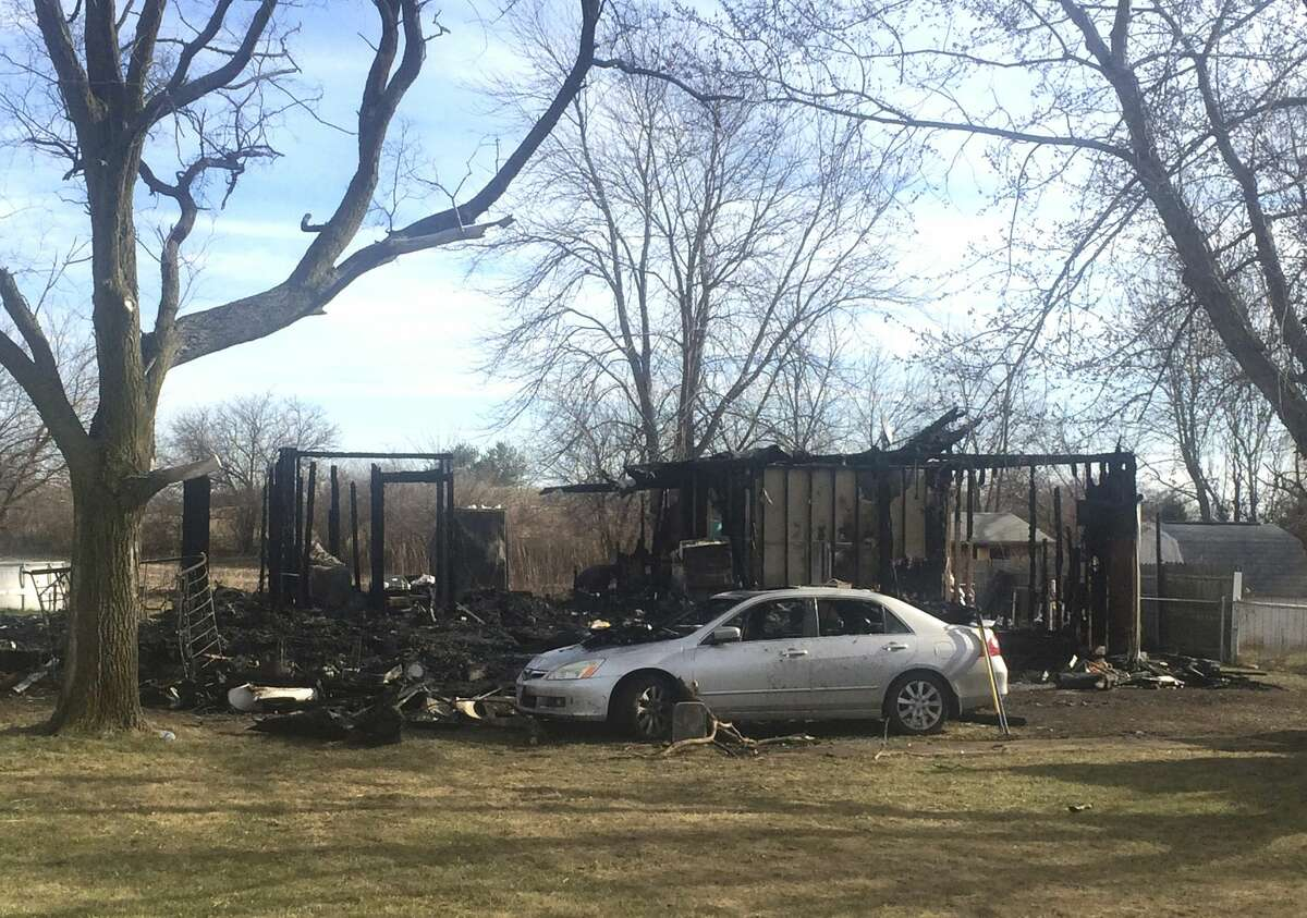 The scene of a house where a grandmother and her three grandchildren were killed in a fire in Fayette County, Ohio, Friday.