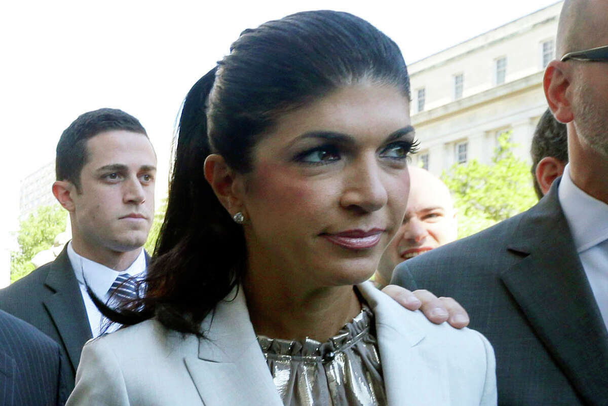 """In this July 30, 2013 photo, """"The Real Housewives of New Jersey"""" star Teresa Giudice, 41, of Montville Township, N.J., walks out of Martin Luther King, Jr. Courthouse after an appearance in Newark, N.J."""
