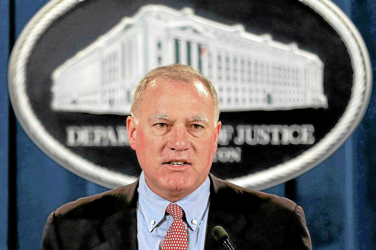 Connecticut Attorney General George Jepsen speaks at the Justice Department in Washington on Feb. 5, 2013.