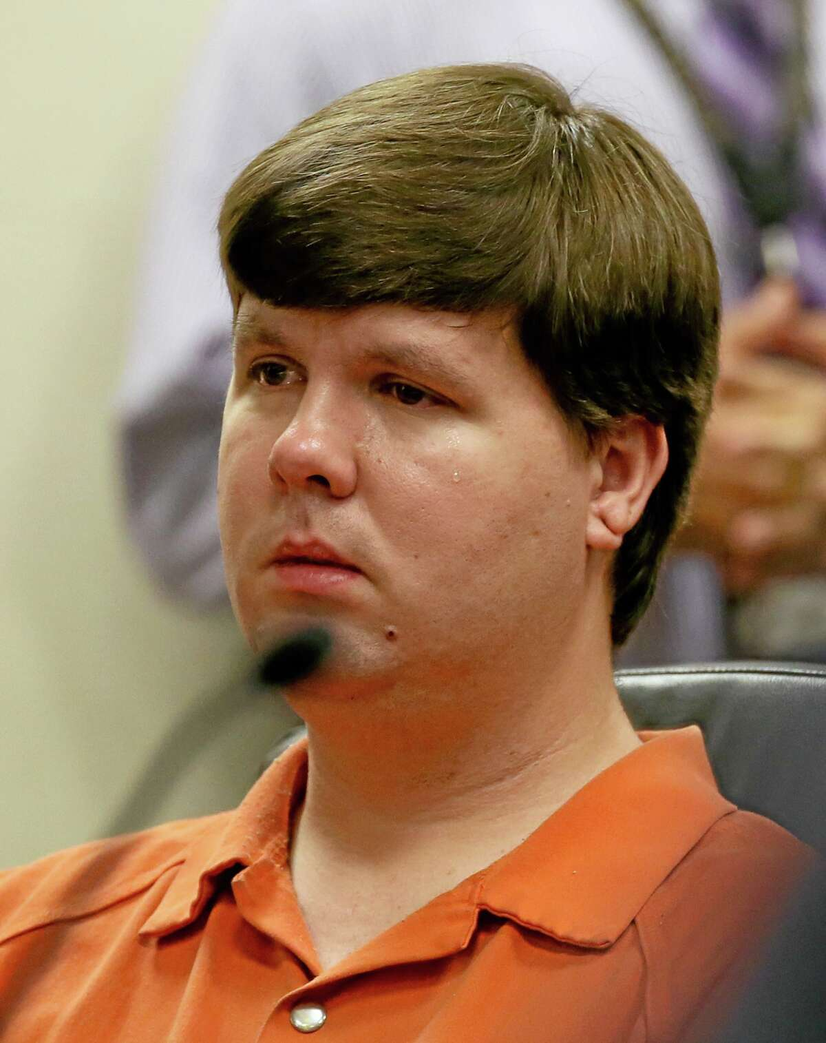 A tear rolls down the cheek of Justin Ross Harris, the father of a toddler who died after police say he was left in a hot car for about seven hours, as he sits during his bond hearing in Cobb County Magistrate Court, Thursday, July 3, 2014, in Marietta, Ga. (AP Photo/Marietta Daily Journal, Kelly J. Huff, Pool)