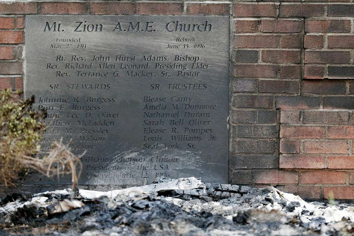 Ashes lie by a cornerstone outside Mount Zion African Methodist Episcopal Church, Wednesday, July 1, 2015, in Greeleyville, S.C. The African-American church, which was burned down by the Ku Klux Klan in 1995, caught fire Tuesday night, but authorities said arson is not the cause. (Veasey Conway/The Morning News via AP)
