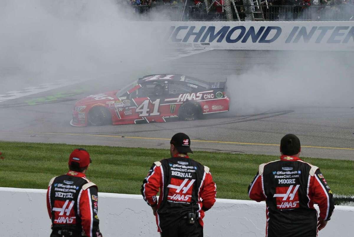 Kurt Busch does a burnout as he celebrates after winning at Richmond International Raceway on Sunday.