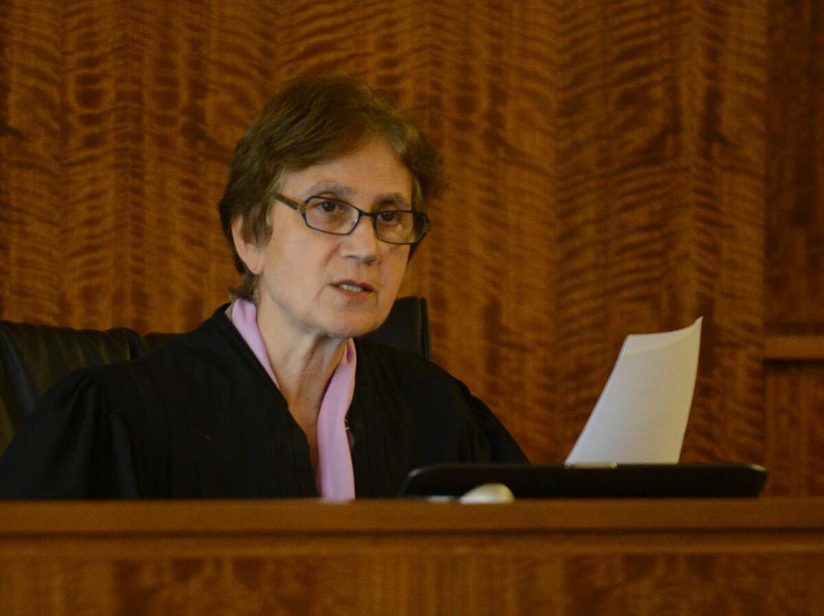 Judge E. Susan Garsh presides at a hearing for Carlos Ortiz and Ernest Wallace, co-defendants of ex-New England Patriots player Aaron Hernandez, at Bristol County Superior Court in Fall River, Mass., Friday, June 26, 2015. Wallace and Ortiz are accused of joining Hernandez to kill Odin Lloyd in 2013. (Ted Fitzgerald/Boston Herald via AP, Pool)