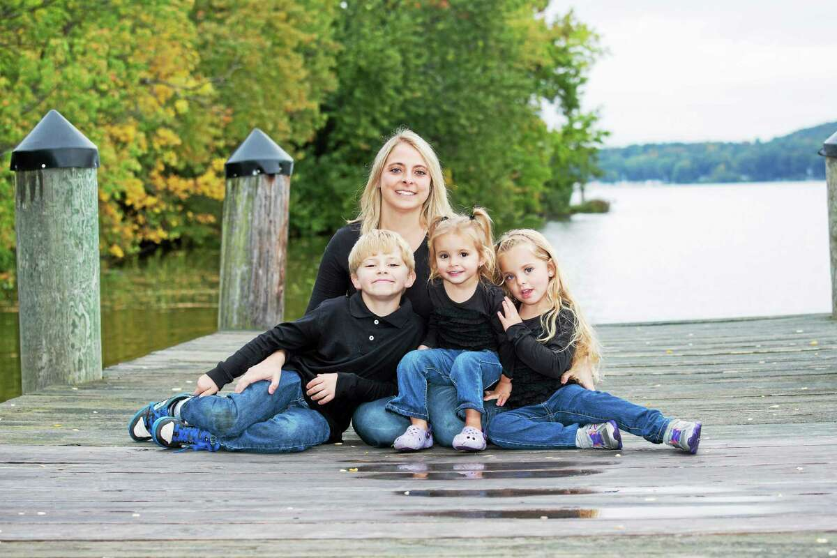 Contributed photo Haddam Killingworth High School Communication Department and Haddam's Youth and Family Services has announced a benefactor for their 26th annual Holiday Telethon. Amanda Lisitano, shown above with her three children, is a 1997 graduate from Haddam Killingworth High School who has been diagnosed with Stage 4 Colon Cancer.
