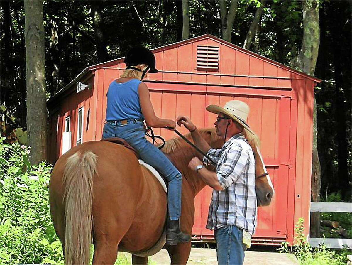 Geoff Goodson, farrier and trainer, will work with six women and their horses July 9-11 in East Hampton to fill the hole in their training and working from the ground up using horsemanship techniques.