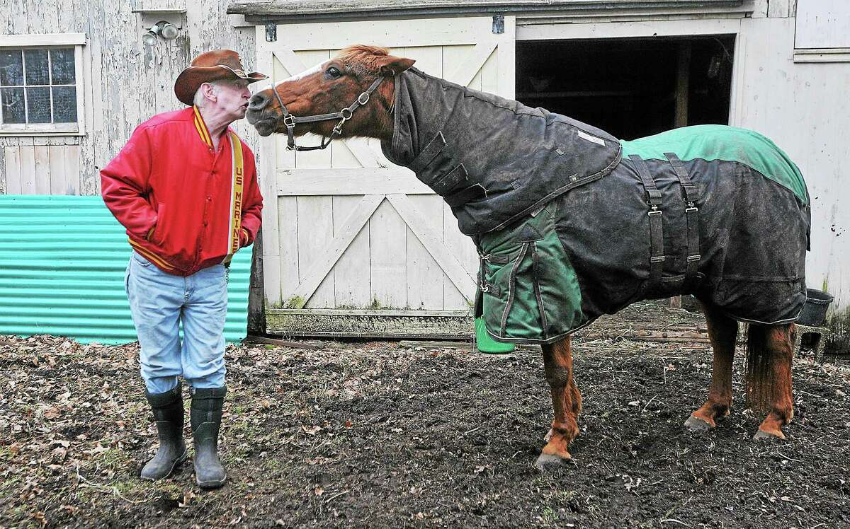 Middletown resident Rick Kowalker is shown with his Morgan Melody in this 2013 photograph. Kowalker, a Marine who served in Vietnam, has attended more than 700 military funeral services in dress blues with Melody, the riderless horse.