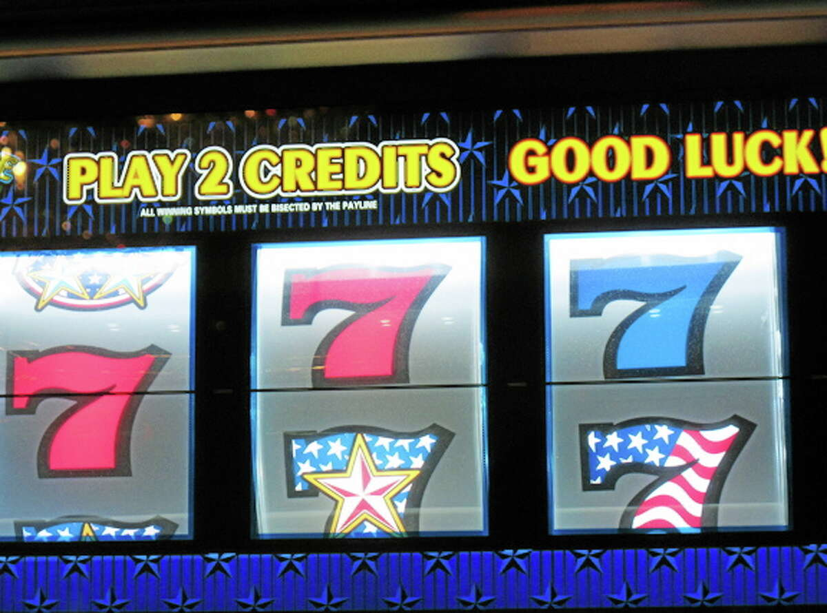 This Nov. 14, 2013 photo shows a slot machine at the Tropicana Casino and Resort in Atlantic City, N.J. The city's casinos saw their gross operating profits fall by nearly 35 percent in 2013 to $235 million, down from $360 million in 2012.