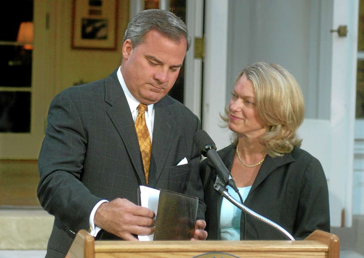 In this June 21 file photo, Connecticut Gov. John G. Rowland, with his wife Patty beside him, finishes his speech after he announced his resignation from office at the Governor's Residence in Hartford.